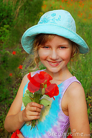Young girl  with bunch of  poppy