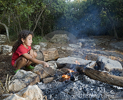 Young girl campfire