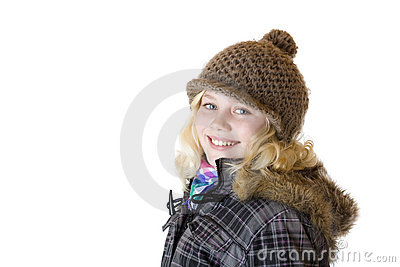 Young girl with cap, scarf and jacket smiles happy