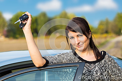 Young girl with car key in hand