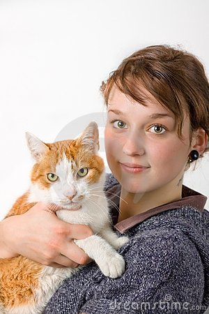 A young girl and cat