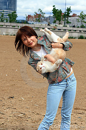 A young girl and a cat.