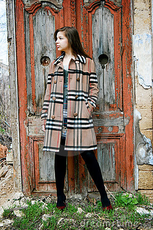 Young girl in checkered coat