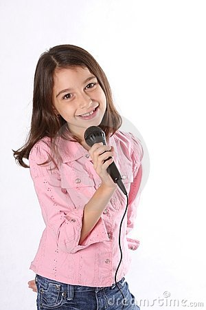 Free Young Girl / Child Singing With Microphone Royalty Free Stock Photo - 4966315