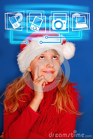 Young girl choosing virtual gift for christmas