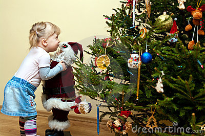 Young girl and Christmas tree