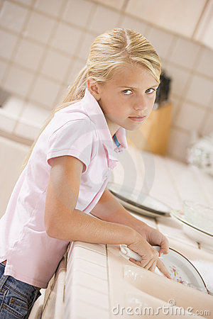 Young Girl Cleaning Dishes