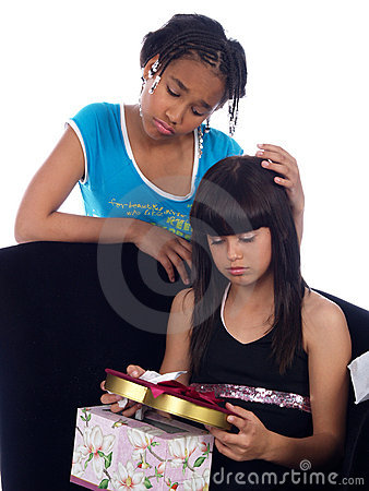 Young girl comforting girl wit