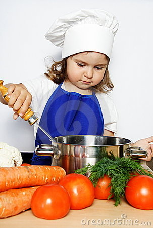 Young Girl in Cook s Cap Preparing Food