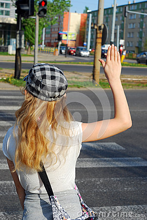 Young girl crossing the street