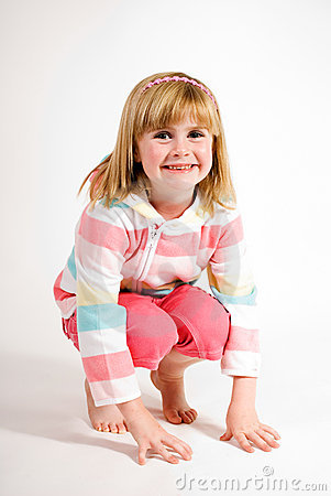 Young girl crouching