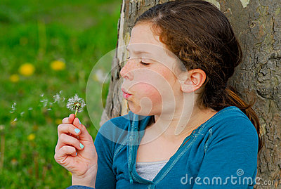 Young girl with dandelion.