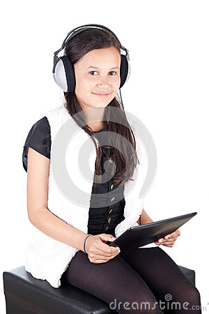 Young girl with digital tablet and headphones