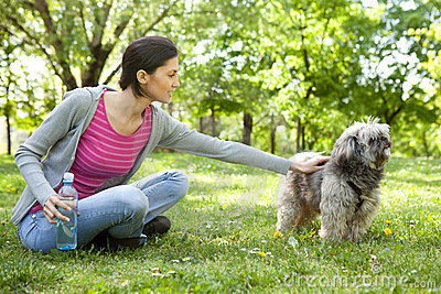 Young girl with a dog in the park