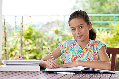 Young girl doing her homework in a home environmen