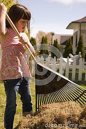 Young girl doing yardwork