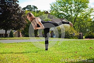 Young girl doing yoga exercise alone