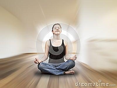 Young girl is doing yoga exercises