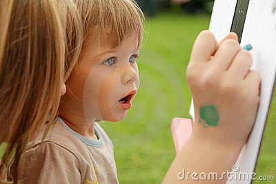 Young Girl Drawing With Her Mother Stock Photo - Image: 9864980