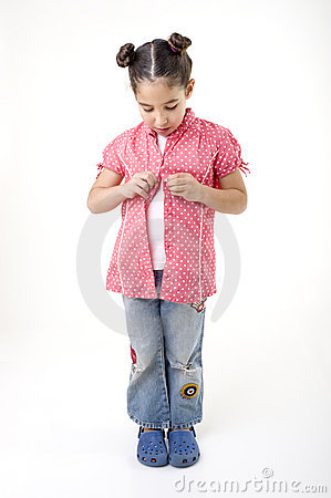Young girl dressing