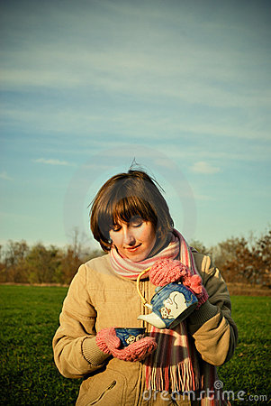 A young girl drinking tea outdoors