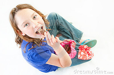 Young girl eating chocolate