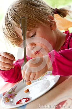 Young girl eating dinner