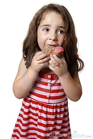 Young girl eating doughnut