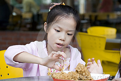 Young Girl Eating Fried Chicken