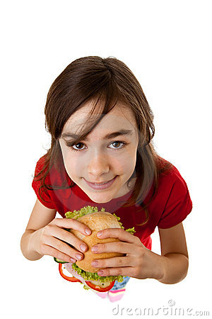 Young girl eating healthy sandwich