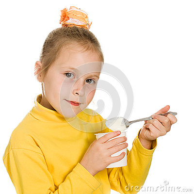 Young girl eating yogurt