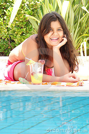 Young girl on edge of pool