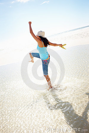 A young girl enjoying her vacation at the beach