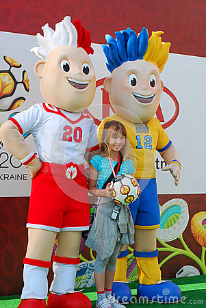 Young girl with euro 2012 talismans Editorial Photo