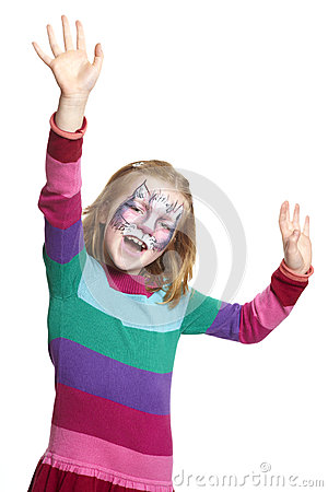 Young girl with face painting cat smiling
