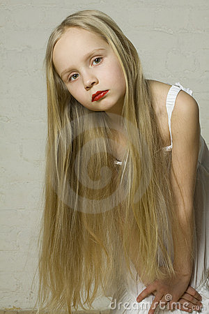 Young girl fashion model with blond hair