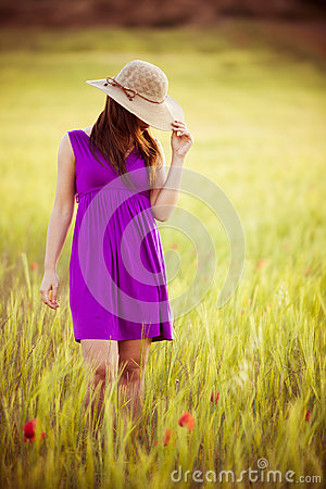 Hiding behind her hat