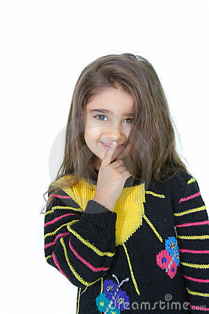 Young girl with finger at her lips