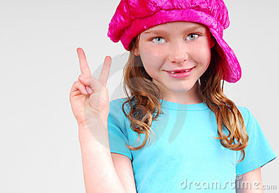 Young girl flashing peace sign