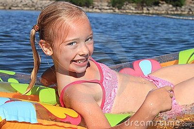 Young Girl Floating in a River