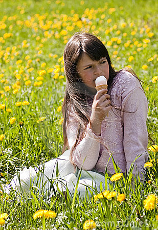 Young girl in a flower meadow