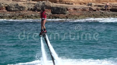 Young girl on flyboard near Ibiza stock video footage
