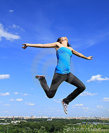 Young  girl flying in the air