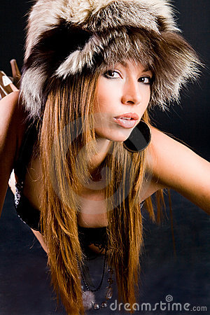 Young girl in fur-cap