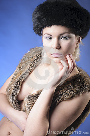 Young girl in fur vest