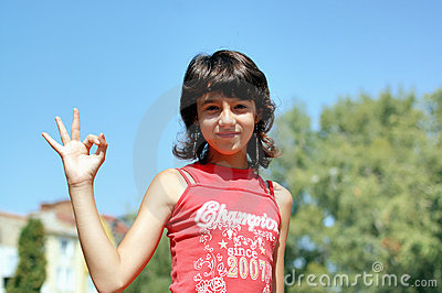 Young girl gesturing okay