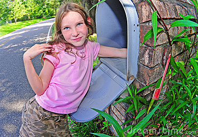Young girl getting the mail