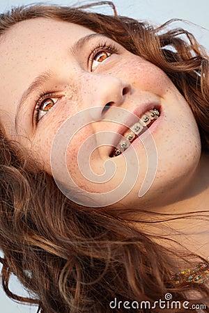 Young girl glancing away