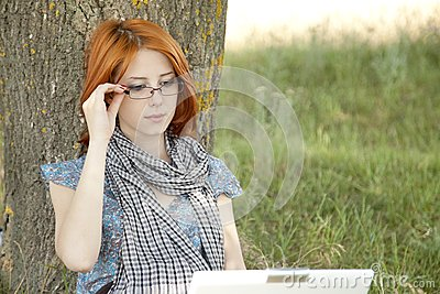 Young girl in glasses and notebook