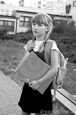 Young girl going to school-black and white image